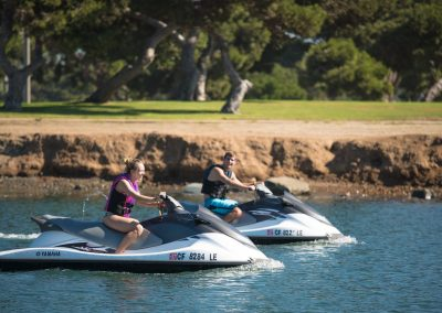 Two people riding Jet Skis in San Diego