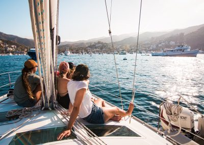 Group of women sitting on sailboat