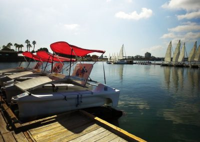 3 pedal boats tied to dock in San Diego