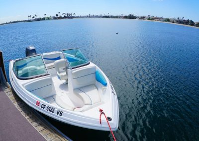 Rinker 13 powerboat tied to dock at Action Sport Rentals