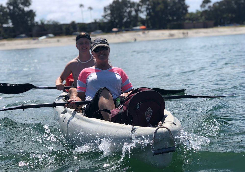 Mom and son on tandem kayak rental